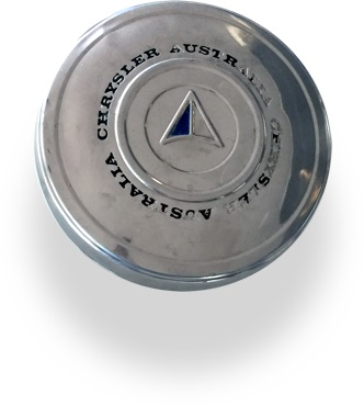"""A vehicle hubcap. The Chrysler chevron logo is in the centre, with the words """"Chrysler Australia"""" circling it."""